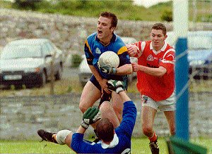 Marty clears his line with help from Enda